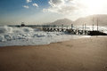 Pier in stormy seas, Nuweiba Egypt Royalty Free Stock Photography