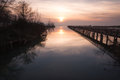 Pier and sunset reflections Royalty Free Stock Photo