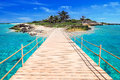 Pier to the tropical island of caribbean sea Royalty Free Stock Photography