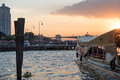 Pier for traveling along Chao Phraya River on regular city boat line in Bangkok during beautiful sunset Royalty Free Stock Photo