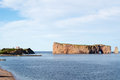 Pierced rock this monolith is located just offshore of perce quebec canada in the gulf of st lawrence it is a major attraction for Stock Images
