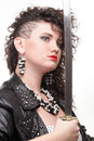 Piercing woman curly girl and sword Royalty Free Stock Photos