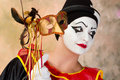 Pierrot with venice mask young female holding a leather Royalty Free Stock Photo
