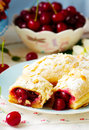 Pies from puff pastry with cherry
