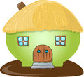 Pig like house green with a thatched roof Royalty Free Stock Image