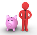 Pig money box and businessman d a next to it Royalty Free Stock Photo