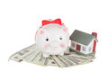 Pig moneybox on money and the toy house Royalty Free Stock Photo