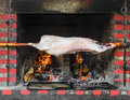 Pig on a spit over fire Stock Photo