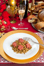 Pig trotter star shaped with lentils over christmas table Stock Image