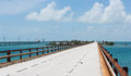 Pigeon key and the old and the new with seven mile bridge going through it bridge bypasses it handrails seen on bridge are Royalty Free Stock Image