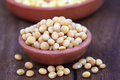 Pigeon pea with other pulses on brown potteries Royalty Free Stock Image