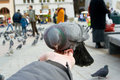 Pigeons feeding and balancing on hand Royalty Free Stock Images