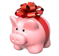 Piggy bank with bow and gifts isolated on white background Royalty Free Stock Photography