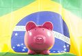 Piggy bank with brazilian flag studio cutout Stock Image