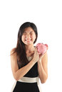 Piggy bank with business woman investment concept Stock Photo