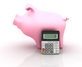 Piggy Bank and Calculator Royalty Free Stock Images
