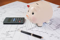 Piggy bank with calculator and business reports pretty Stock Photo