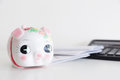 Piggy bank calculator and statement over the white background Stock Images