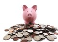 Piggy bank on coins Royalty Free Stock Photo