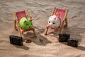 Piggy bank in a deck chair is photo icon for airline travel and vacation costs Stock Photography