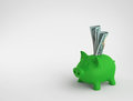 Piggy bank with dollar bills Royalty Free Stock Photo
