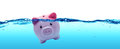 Piggy bank drowning in debt Royalty Free Stock Photo