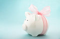 Piggy bank gift of money cute with pink bow and ribbon side view Stock Images