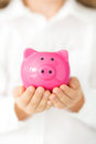 Piggy bank hands holding pink Stock Photography