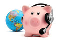 Piggy bank with headset and globe isolated on white backround Royalty Free Stock Photo