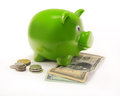 Piggy bank isolate with bills and coins Royalty Free Stock Photos