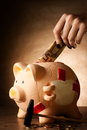 Piggy bank with money and hammer on tabletop Royalty Free Stock Photos