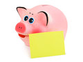 Piggy bank and note paper isolated on white background Royalty Free Stock Images