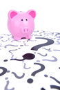 Piggy bank question what o do with money Stock Images