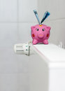 Piggy bank with radiator thermostat saving heating costs save energy euro banknotes next to a on the Royalty Free Stock Photography
