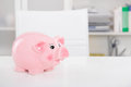 Piggy bank savings gone on holiday background for money or sa saving concepts also affairer Royalty Free Stock Images