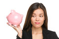 Piggy bank savings with unhappy funny woman looking displeased at pink isolated on white background business or Stock Image
