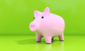 Piggy bank shiny pink on a green background Stock Photo