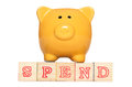 Piggy bank with spend alphabet blocks Stock Photography