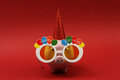 Piggy bank with sunglasses Happy birthday, party hat on red background Royalty Free Stock Photo