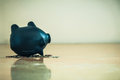 Piggy bank upside down and coins debts and financial problems concept. Royalty Free Stock Photo