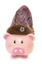 Piggy bank wearing purple wooly hat cutout Royalty Free Stock Photo