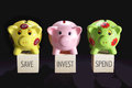 Piggy banks on black background Stock Image