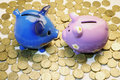 Piggy Banks and Coins Stock Image