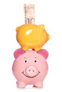 Piggy banks with scottish money studio cutout Royalty Free Stock Photos