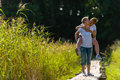 Piggyback lovely lesbian couple are together sunny day Stock Image