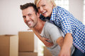 Piggyback ride we are so happy from our new apartment Royalty Free Stock Photography