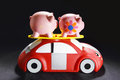 Piggybanks op toy car Stock Fotografie