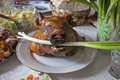Pigs head on barbaque at plate Royalty Free Stock Photo