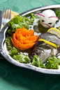 Pike perch elegant dish served of with lemon carrot and decorated egg Royalty Free Stock Image