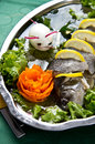 Pike perch elegant dish served of with lemon carrot and decorated egg Stock Photo